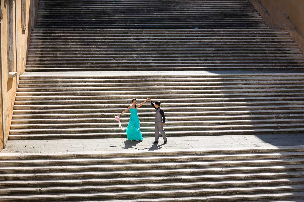 Pre wedding matrimonial photo session. Standing on stairs. Stepping down.