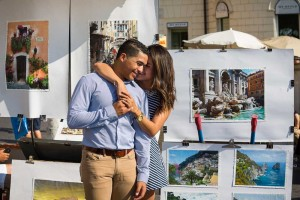 Engaged in Italy. Picture of a couple in front of paintings.