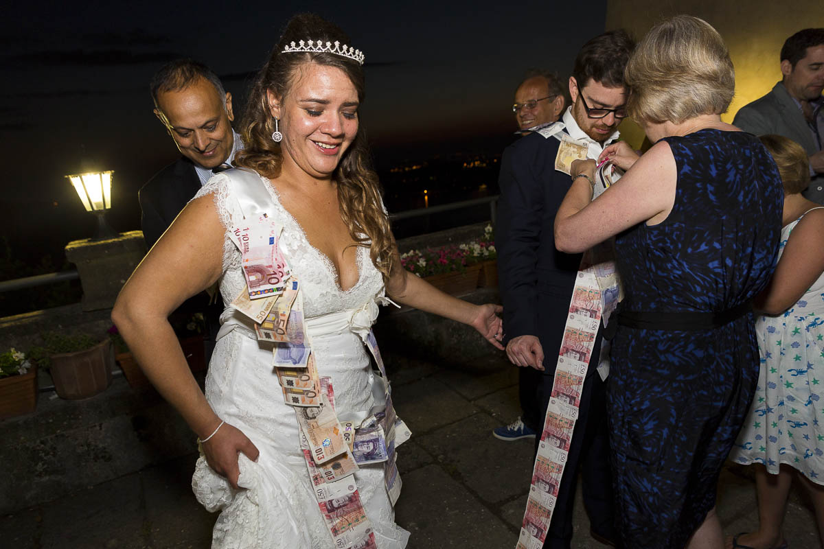 Money dance. Pinning money onto the newlyweds. Greek wedding tradition.
