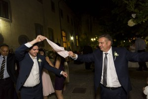 Dancing while holding a handkerchief . Greek wedding tradition.