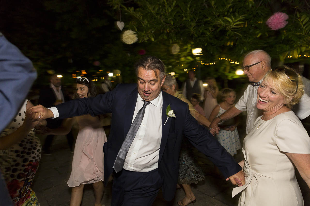 Greek wedding traditions. Dancing around the bride and groom.