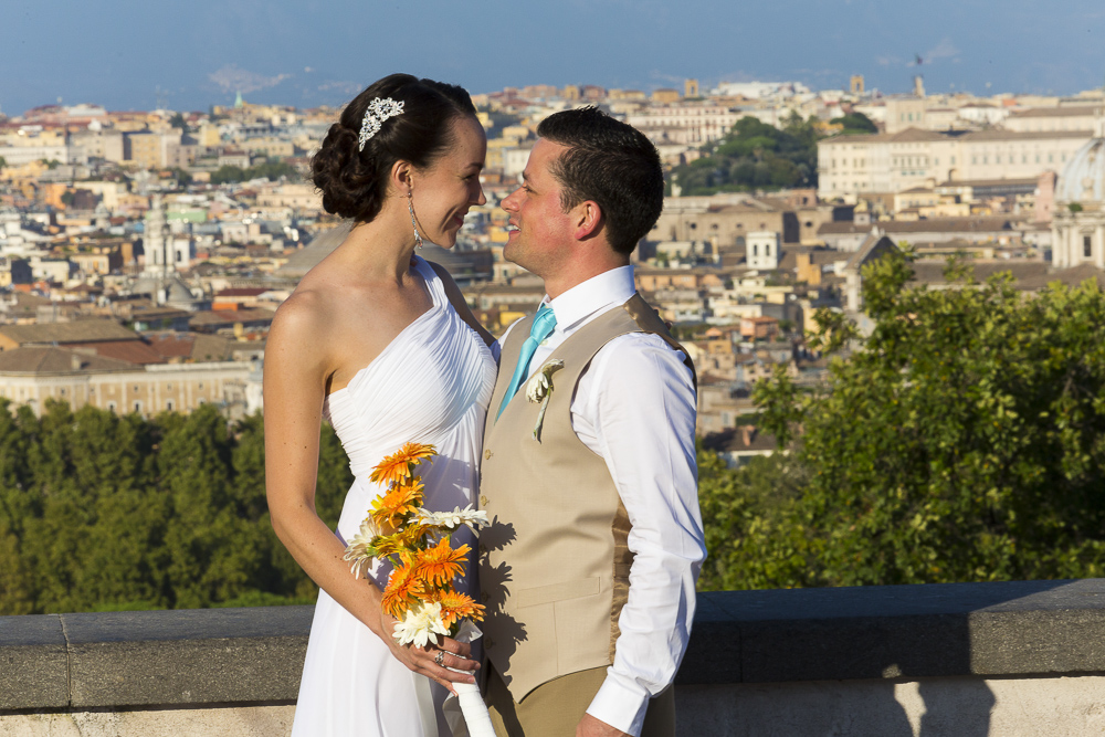 Getting married abroad in Rome Italy. At the Gianicolo hill with a beautiful view over the city.