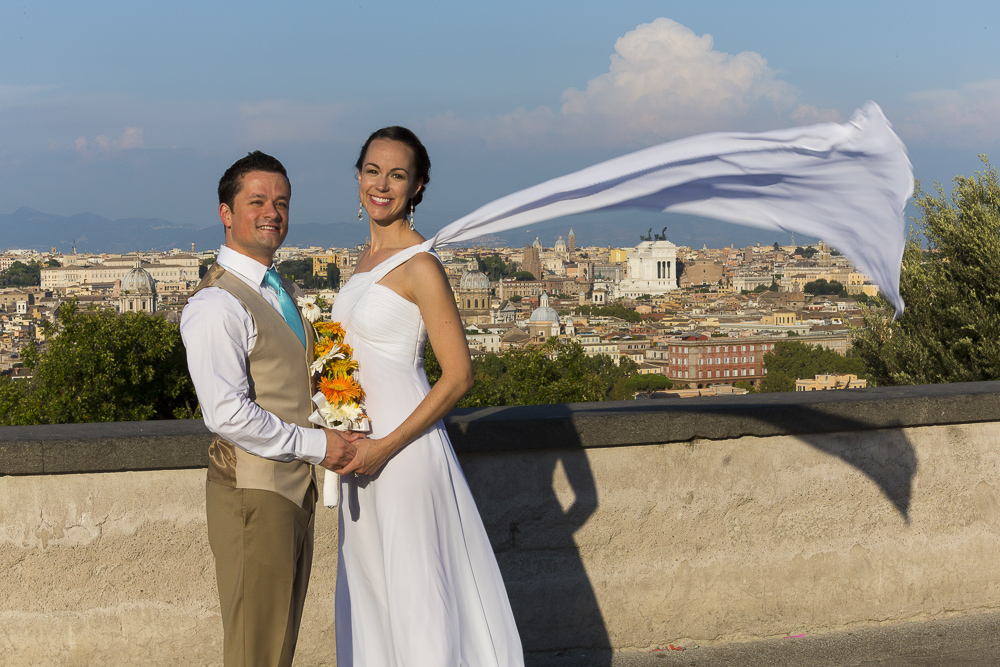 Bride and groom together after marriage. Photo of the wedding dress flying up in the air.