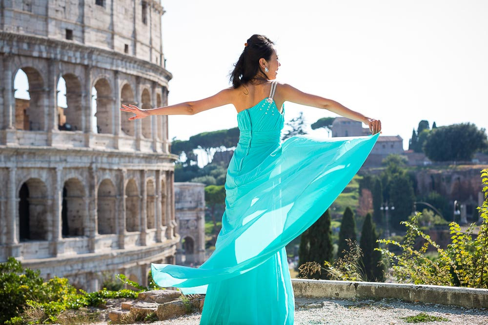 Dress picture of a girl rotating in a circle by the Coliseum.