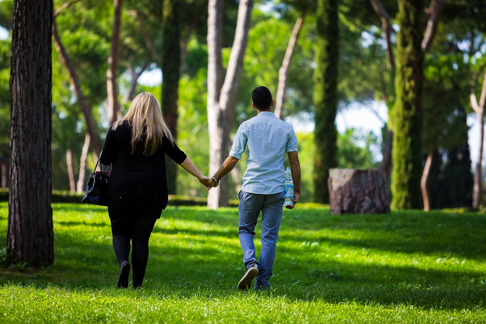 Walking together in a park hand in hand.