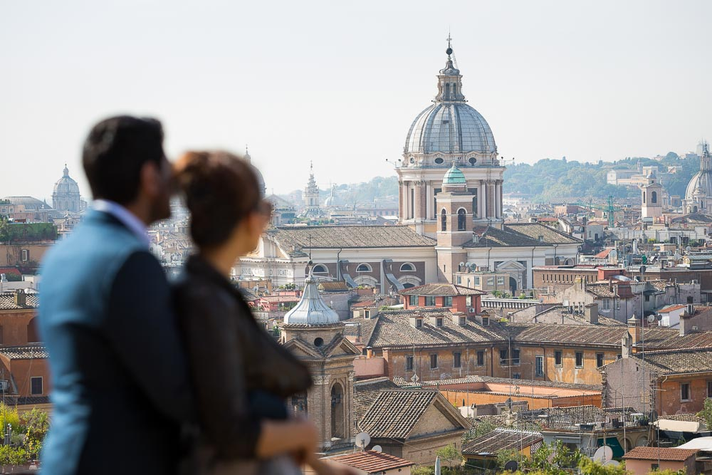 Couple view over the roman rooftops in Rome