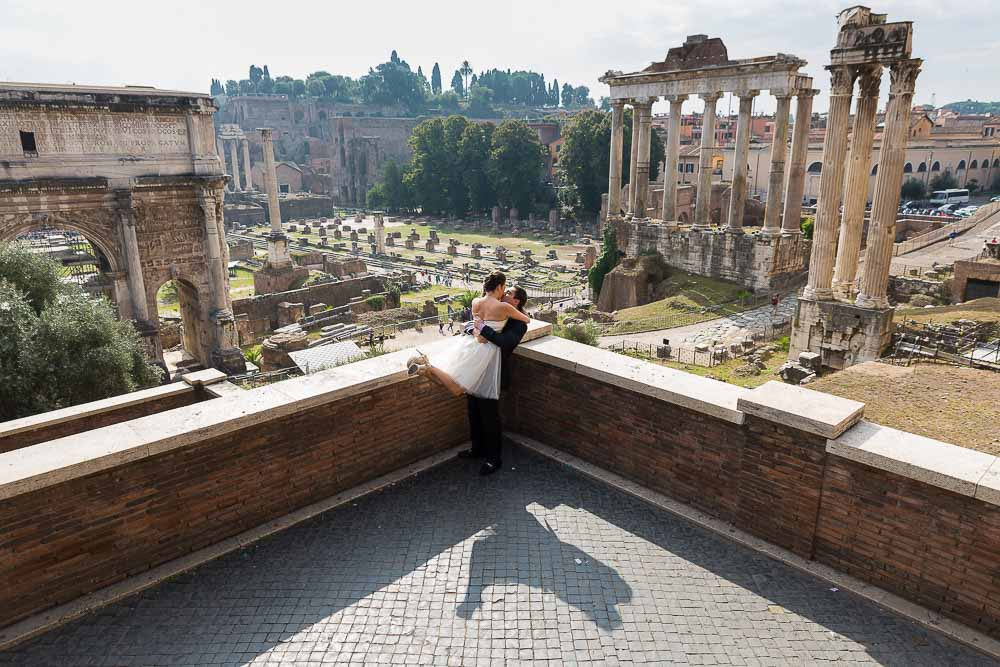 Wonderfully happy and in love during a photo shoot overlooking the ancient forum. Rome Honeymoon.