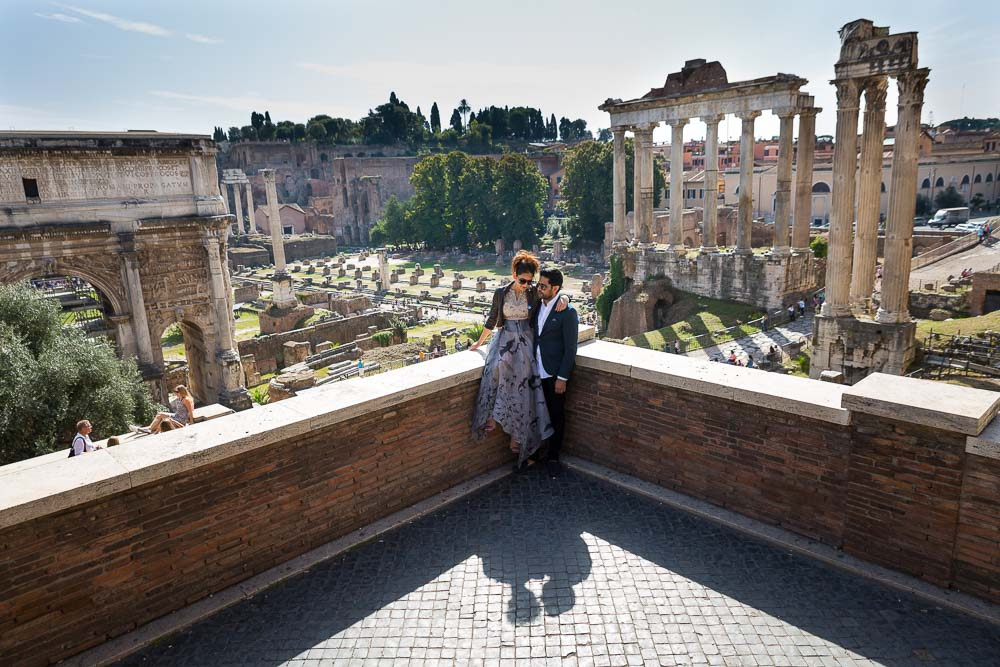 Picture of a man and woman at the ancient Forum with the ruins in the background.