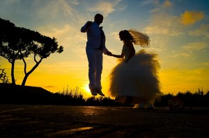Wedding photography at sunset. Jumping in the air.
