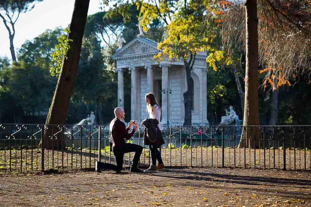 Lake side wedding proposal photographed at the Villa Borghese park in Rome, Italy.
