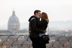 Kissing in Rome with the beautiful skyline behind