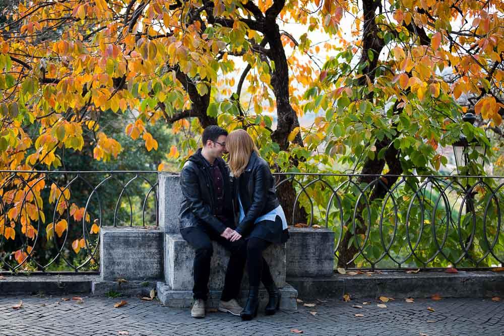 Portrait photography session among autumn leaves