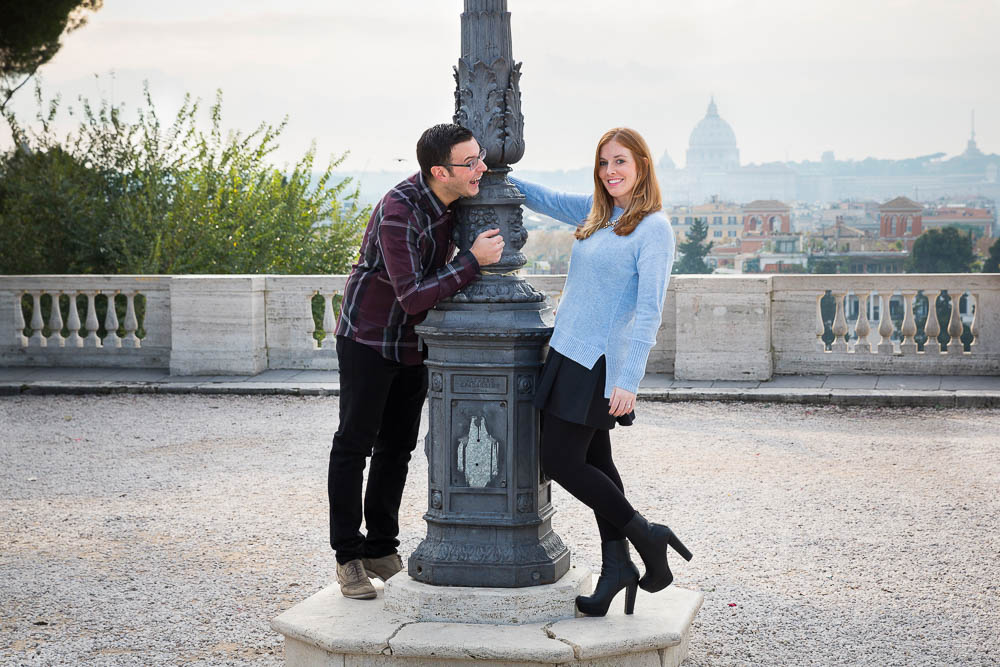 Posing during an engagement session in Rome