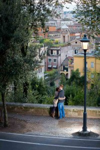 Couple close together during an engagement session in the roman streets.