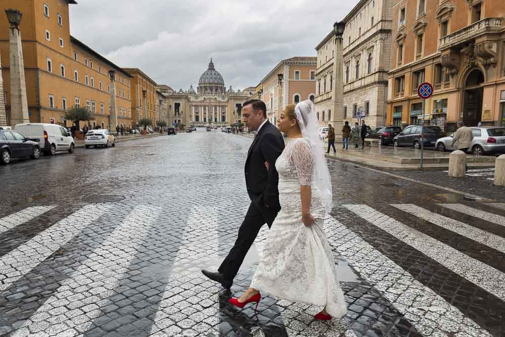 Crossing the streets with the St. Peter Cathedral dome in the background.