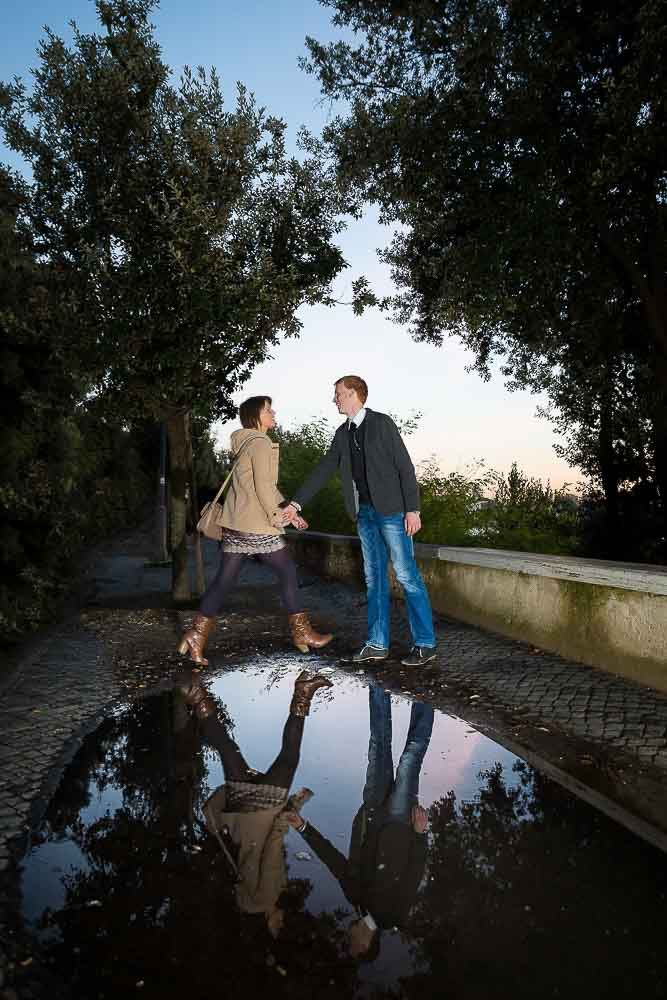 Jumping over puddles during a creative engagement session by Andrea Matone photographer.