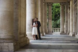 Leaning underneath columns in Piazza del Campidoglio.