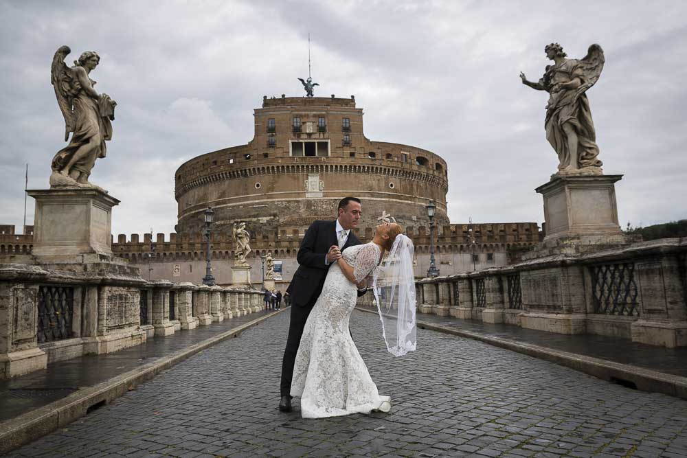 Dipping the bride on the Castel Sant'Angelo bridge.