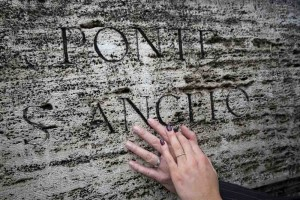 Hands and rings on the ancient marble of Castel Sant'Angelo.