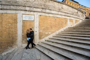 Picture taken of a couple posing on the Spanish steps in Rome