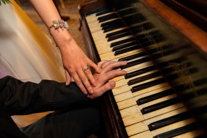 Hands playing on piano