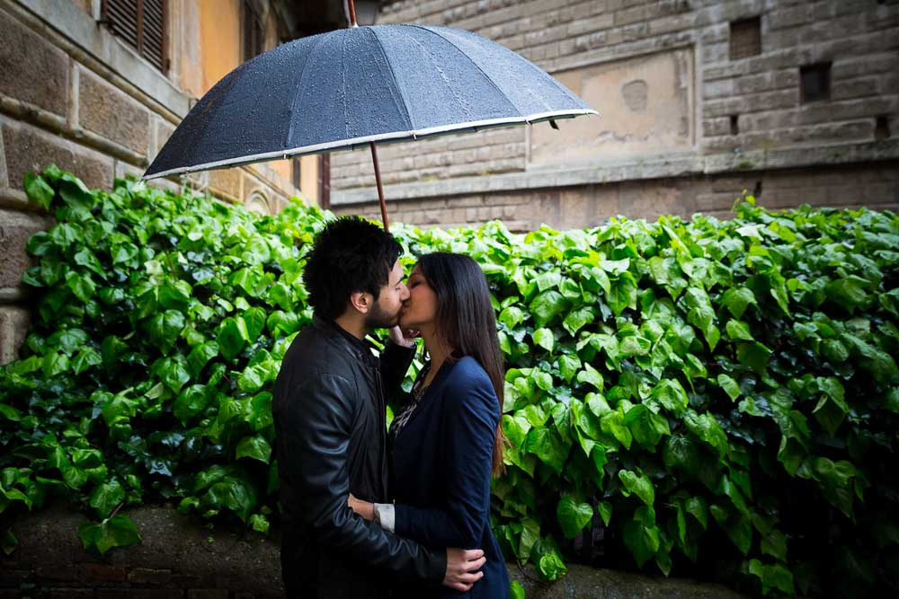 Engagement session in the rain under an umbrella