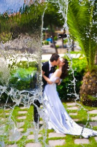 Wedding photo session behind water fall.