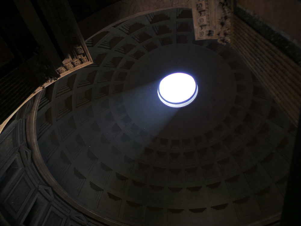 Light shining through the hole inside the Roman Pantheon.
