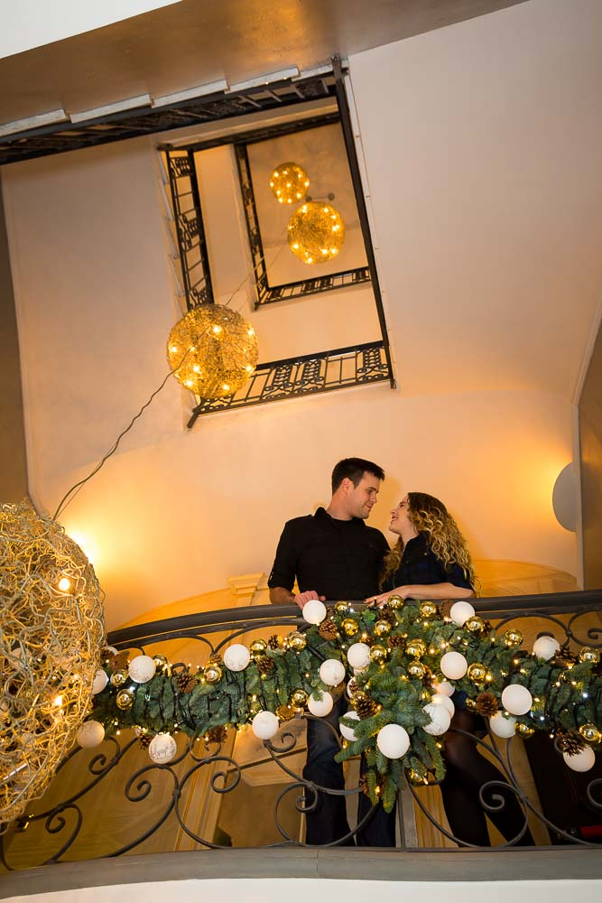 Hotel interior engagement session on the stairs of Hotel Anselmo