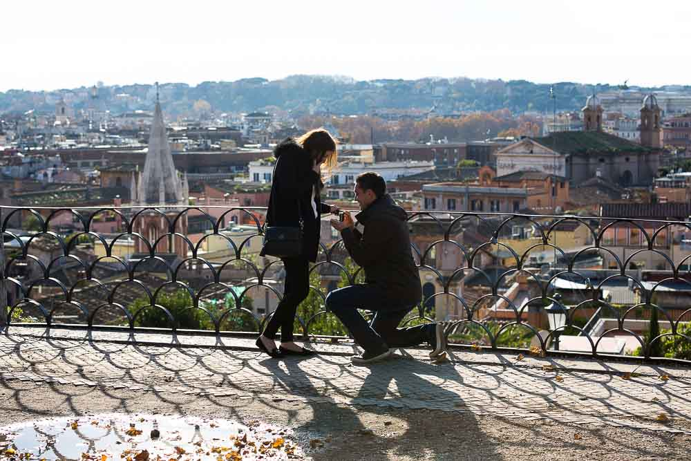 Marriage proposal ideas in Rome. One knee down. Overlooking the city.