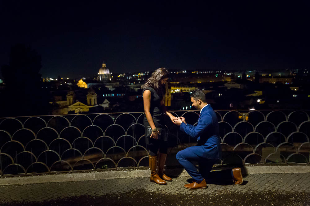 Surprise wedding proposal. Photographed at night at Parco del Pincio in Rome Italy.