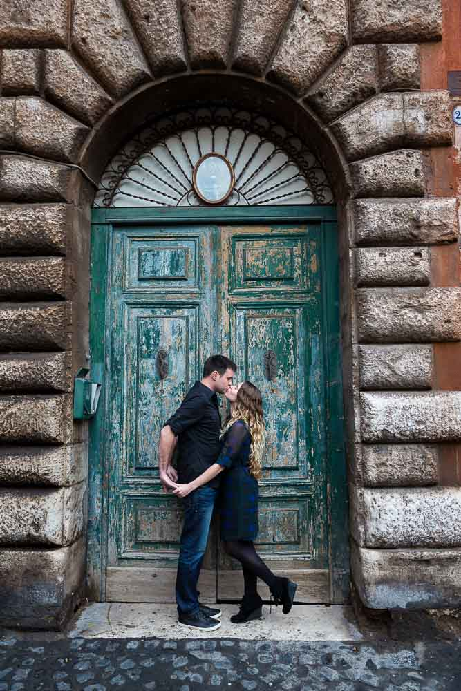 Image of a coupe in love photographed in front of an old roman door