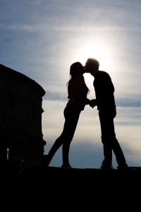 Silhouette picture of an engagement photographed at the Roman Colosseum. Rome, Italy.