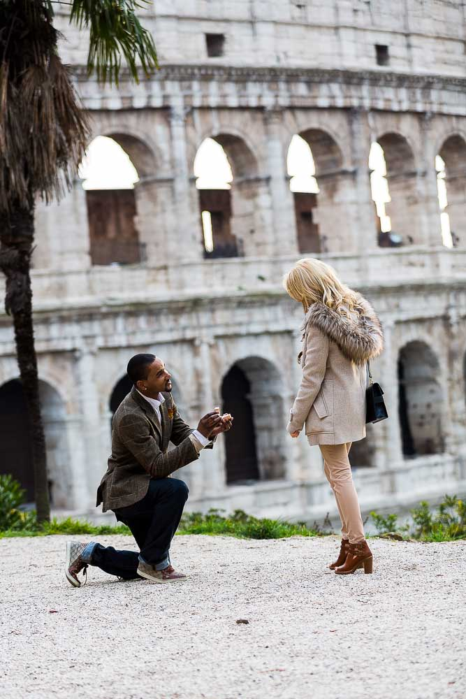 Engagement Proposal. One knee down at the Roman Colosseum.