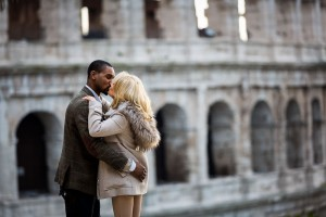Kissing at the Coliseum. Romantic imagery from unique roman landmark