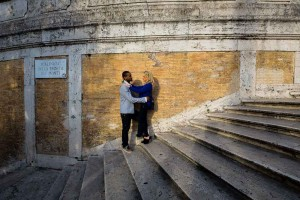 Standing on the Spanish steps during an engagement session