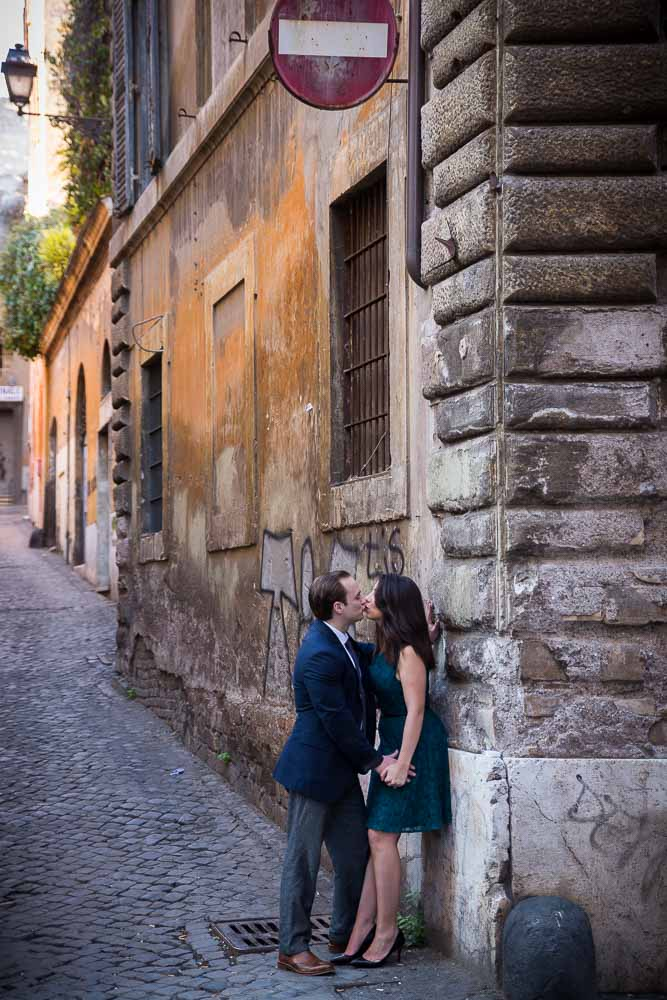 Kissing in an alley in the city of Rome