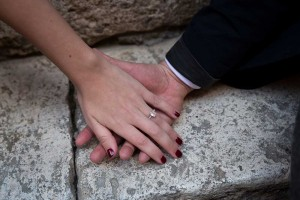 Engagement ring. Holding hands together.