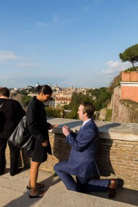 Man asking his fiancee for marriage in Rome.