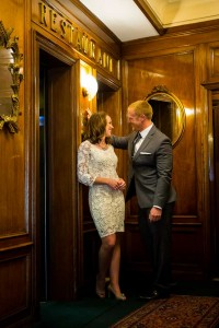 Closeup vertical shot of a couple inside a Hotel romantically standing by an elevator.