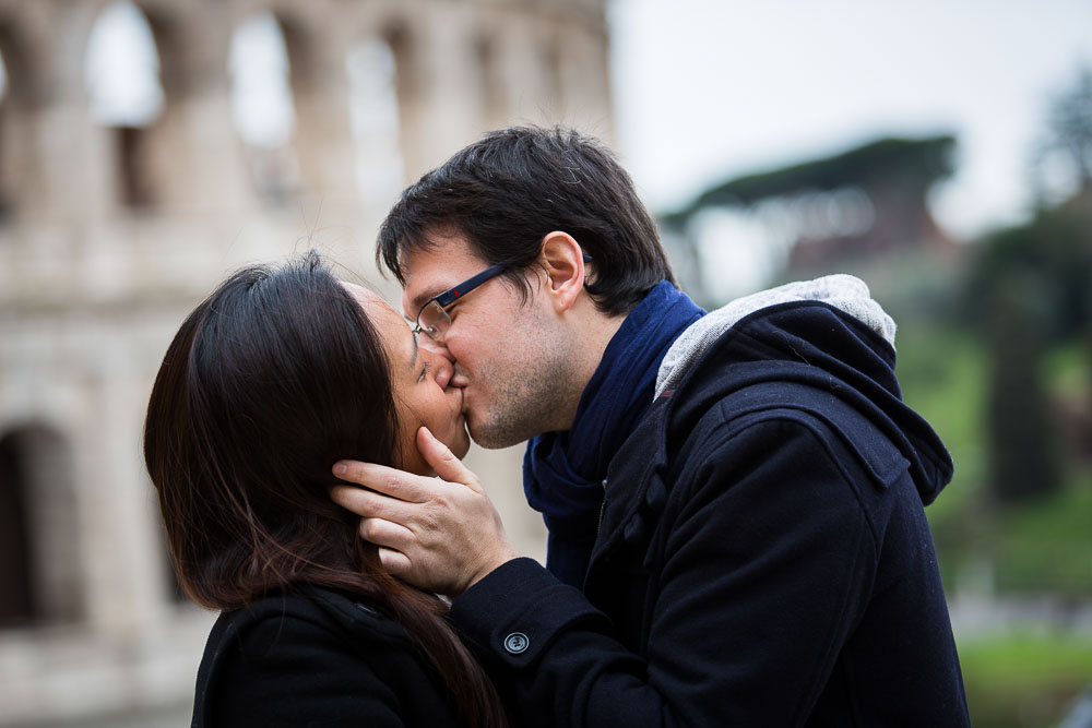 Just engaged. Couple kissing at the Coliseum in Rome