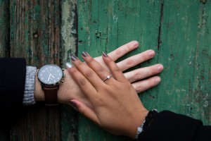 Close up of the engagement ring photographed on an old door