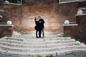 Posing on top of a staircase during an engagement session in Rome