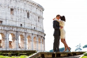 Bride and groom together at the Roman Colosseum posing for a photography session