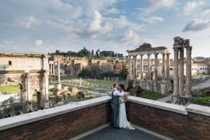 Newly wed couple overlooking the ancient forum