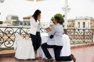 Man proposing down on one knee