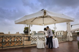 Couple just engaged kissing after the marriage Roof Garden Proposal