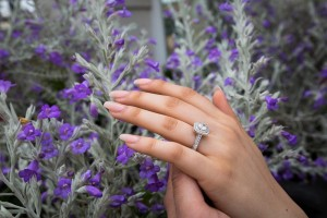Engagement ring picture of a couple holding hands
