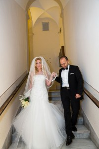 Bride and groom descending stairs