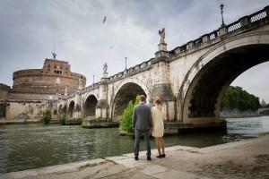 Couple pre wedding session underneath the Castel Sant Angelo bridge in Rome Italy